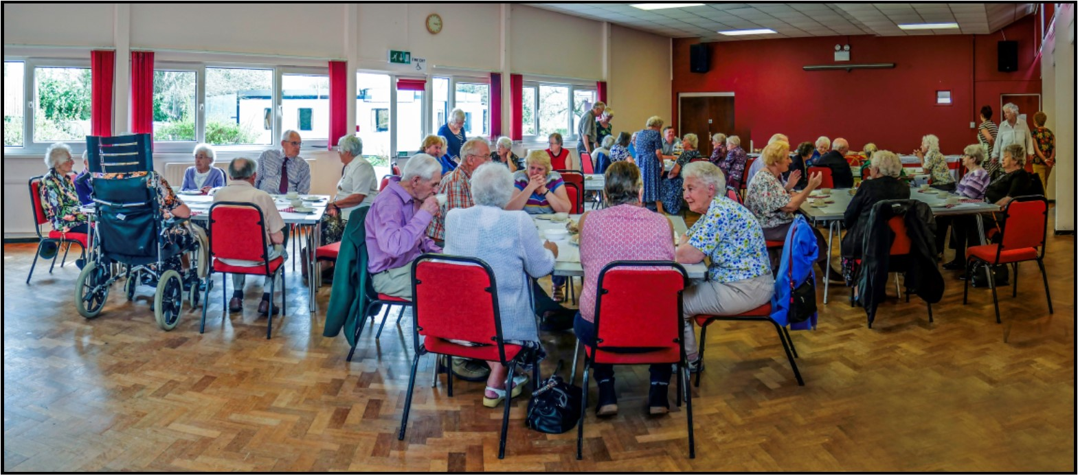 Guests enjoying the Over 85's tea party